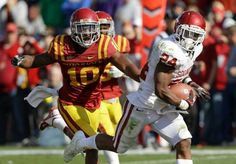 Brennan Clay, right, runs from Iowa State defensive back Jacques Washington during an 18-yard TD run last Saturday - Clay had 157 yards and this TD in the 35-20 win for the Sooners