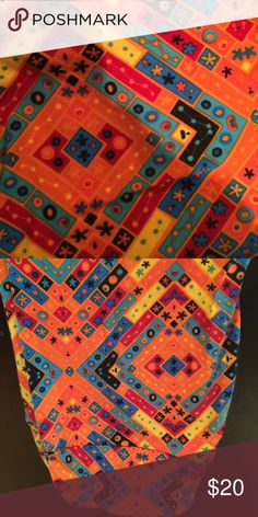 NWOT LULAROE TC ORANGE MULTICOLOR  NEVER WORN NWOT LULAROE TC ORANGE MULTICOLOR  NEVER WORN. BEAUTIFUL BRIGHT COLORS. JUST IN TIME FOR SPRING. LuLaRoe Pants Leggings