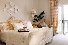 Antique Appeal - Gracious Guest Bedrooms - Southernliving. Soft and graceful, the room reflects timeless style with its shades of caramel, coffee, café au lait, and gold. Luxury prevails with the antique bed and hand-printed cotton duvet. Also featured is an oversize chair in a rich caramel-colored fabric with gray trim. Shells, plates, and ornate frames are used as decorative touches.