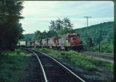 Central Vermont train # 447 switching at Palmer Ma. with Grand Trunk GP38 # 5804-5801-5802-5809-CV GP9 # 4138.  Photo was taken on June 8, 1990.