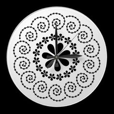 Black flowers on white, round wall clock by imagineallart