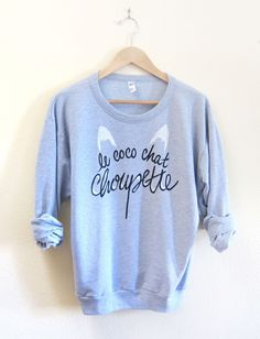 Le Coco Chat Choupette - Drop Shoulder Hand Stenciled Crew Neck Chanel Muse Sweater in Martini Blue Heather - S M L XL 2XL. $54.00, via Etsy.