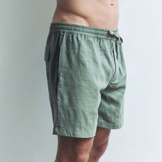 Dark Khaki linen shorts can combine with most of your summer shirts. Made from soft organic linen and featuring a drawstring waistband, they're our favourite, breathable and versatile wardrobe staple. Perfect shorts for every occasion.  Dark Khaki Relaxed fit  Drawstring waistband   Single pocket at the back 100% Linen  Cool wash, hang dry  Model wears size XL / 36 inch waist Dark Khaki, Linen Shorts, Summer Shirts, Wardrobe Staples, Label, Organic, Pocket, Fit, How To Wear