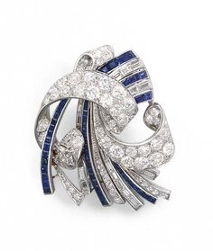 AN ART DECO DIAMOND AND SAPPHIRE BROOCH   Designed as a baguette-cut sapphire and diamond and old European-cut diamond spray, gathered by an old European-cut diamond scrolled ribbon, with a cushion-cut diamond accent, mounted in platinum, circa 1925