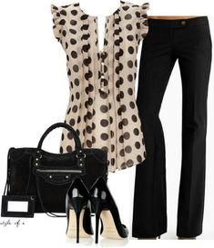 This polka dot retro style top is perfect paired with black pants & a black satchel.