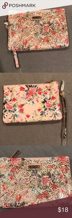 Floral clutch Floral clutch with rose gold inner lining. Brand new never worn. Aldo Bags Clutches & Wristlets