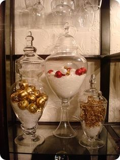 Fill apothecary jars with faux snow and ornaments