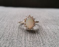 Antique Opal Diamond Engagement Ring Edwardian Victorian! I never cared for engagement rings, never wanted one in my life,(my husband loved that haha) not even a ring person however this ring .........