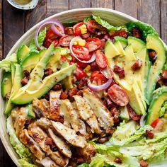Honey Mustard Chicken Bacon + Avocado Salad Recipe Salads with honey, whole grain mustard, dijon mustard, olive oil, minced garlic, salt, boneless chicken thighs, diced bacon, romaine lettuce leaves, grape tomatoes, avocado, corn kernels, purple onion