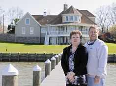Dream Home: Homeowners Roy and Mary Jones stand on the boat dock outside their rebuilt Middle River dream home.