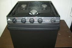 http://www.replacementmotorhomeparts.com/motorhomeappliances.php has a product listing of some appliances that can be installed in a motorhome.