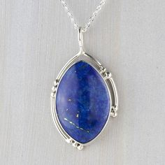 This large lapis pendant is a beautiful way to add some luck to your life. Oval lapis lazuli stone set in a sterling silver frame exudes confidence. Unique Necklaces, Silver Necklaces, Sterling Silver Pendants, Silver Jewelry, Gemstone Necklace, Pendant Necklace, Wire Jewelry Patterns, Diamond Pendant, Diamond Jewelry