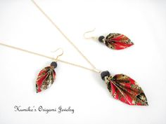 This set of origami leaf necklace and earrings is hand made with Japanese traditional origami paper, called chiyogami & 14KG findings. The leaves are coated with a high quality liquid finish, so durable and water proof.   www.facebook.com/kumikosorigamijewelry  www.etsy.com/shop/KumikosOrigami