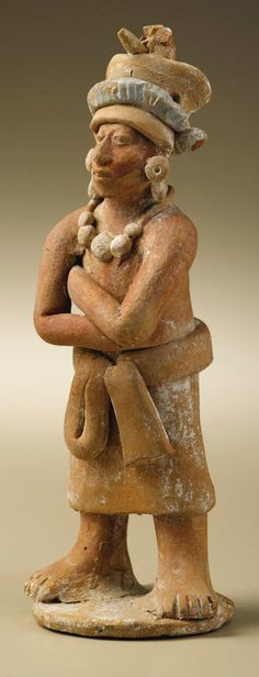 Standing Male Dignitary with Folded Arms. Maya, Jaina. A.D. 550 | Lot #47003 | Heritage Auctions