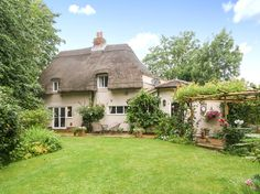 How Wood Cottage is a beautiful Grade II thatched cottage located in the heart of Elmstone, near Canterbury.