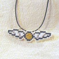 "This Harry Potter inspired sprite pendant features a classic flying ""Golden Snitch."" The wings are a simple pattern of white and gray, but the Snitch itself is done in glittery metallic gold thread.  This Harry Potter sprite measures approx 1 x 2.5 inches.  This cross stitch pendant necklace ..."
