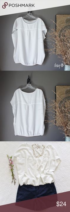 """LOFT Drape Sleeve Blouse Who says fashion doesn't have to be comfortable?  This off white top by Ann Taylor LOFT is super cute and comfy.  A nice, extra benefit... covers the back of the arm problem area some of us have (arm flab 😜). 100% poly, great condition. Machine wash, hang to dry.  Chest approx 20"""", shoulders 16"""", length 27"""" LOFT Tops Blouses"""