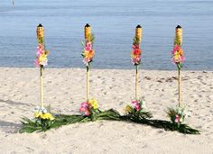 Beautiful tropical beach wedding set up on Smather's Beach in Key West. Easy and simple setup with decorated tiki torches! www.ezweddingsinparadise.com