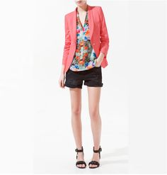 Pink blazer, black shorts