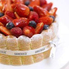 Charlotte_    This cake is sometimes called the 'ice box' cake because sponge fingers are used to line a mould and this is then filled with homemade vanilla mousse and vanilla sponge before being topped with fresh strawberries from USA and Korea.  $35
