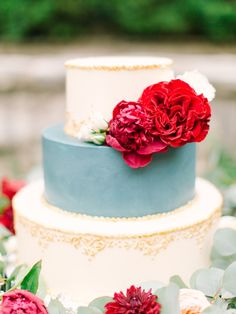 Elegant dusty blue and gold cake with red flowers: http://www.stylemepretty.com/little-black-book-blog/2015/02/06/romantic-cranberry-dusty-blue-wedding-inspiration/ | Photography: Mint - http://mymintphotography.com/