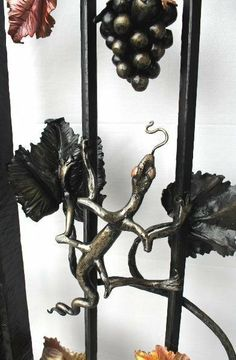 Custom Made Wrought Iron Gates by Paula and Larry Jensen of Earth Eagle Forge LLC, Longville MN | Price range $2,000 - $60,000 | Wrought iron gates are custom made for your door entry, driveway, or vineyard. I hand hammer each individual leaf to create artistic detail. I sketch ideas based on your description and personal preferences. Wrought iron gates can be accented with differing metals such as copper to add a colorful dimension.