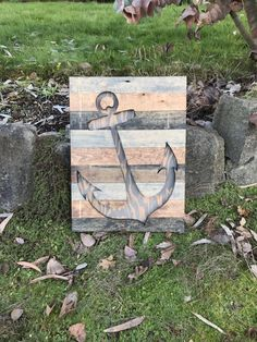 This rustic nautical wood anchor silhouette wall art is made out of pine uniquely stained to look like rustic reclaimed wood. These colors give this piece a rustic modern look. This piece measures 23x17 and is preinstalled with hanging on the wall. This piece is available to be made in different sizes and with a different assortment of colors. Just message me for details.  **NOTE - This piece is made to order. The picture displayed is the template and will be the same design but may have…
