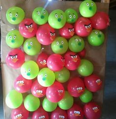 Love this!  Adjust theme to fit your party.   Angry bird and hog balloons. We filled them with candy and let the kids throw darts at them. More fun then a pinata!