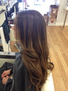 Soft caramel bayalage summer highlights on long dark hair