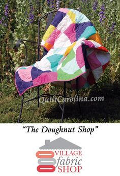 """""""The Doughnut Shop"""" – practice your curve piecing with this beautiful quilt inspired by doughnut cases. Use clever quilting to give the impression of doughnut holes in the middle of the circles! A 2017 Quilt! Carolina pattern."""