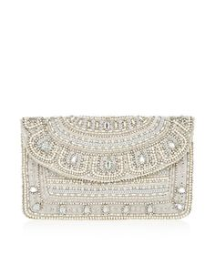 Perfect for special occasions, this embellished clutch bag is decorated with lustrous jewels, sequins and beads. Carry this satin-lined piece in hand, or wear it over your shoulder using the concealable strap.