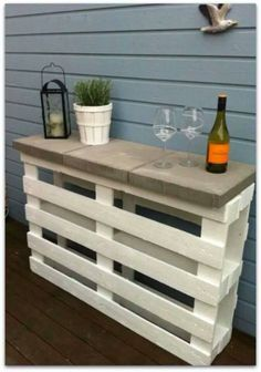 DIY outdoor table made of pallet and concrete plates