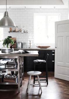 cement counter tops, black bottom cabinetry