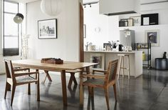 My fave combo of wood, concrete and white. Nice chairs.