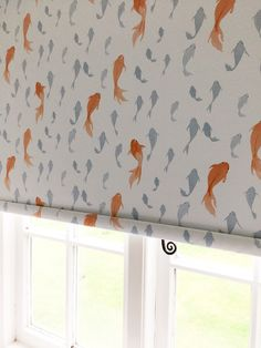 This roller blind for a bathroom with orange and blue fish makes a real feature.