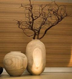 beautiful wooden vase made from one single peace of wood from paulownia tree
