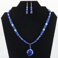 Hey, I found this really awesome Etsy listing at https://www.etsy.com/listing/8465401/bold-blue-lapis-beads-lampwork-pendant