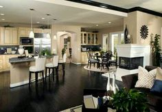 I love the colors and how the kitchen is open to both the dinning room and the living room.