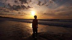 Aston embracing the beach