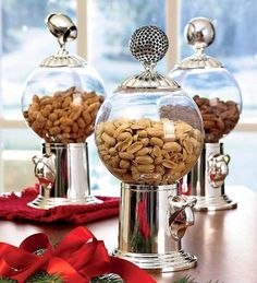 """Antique Reproduction Globe Snack Dispenser with Shiny Globe Finial by Plow & Hearth®. $29.95. Fill this fun-loving Snack Dispenser with Plow & Hearth peanuts, M, trail mix or your favorite treat. A simple touch of the finger dispenser on this antique reproduction releases a measured portion of fresh, clean candy or nuts. Globe unscrews from the base for filling and washing. Sure to become a family or office favorite! Size: 5"""" dia. x 10-1/2""""H; holds 12-16 oz."""