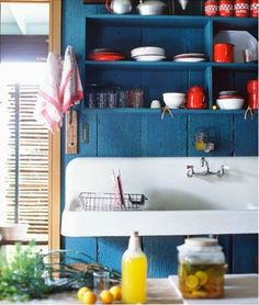 blue kitchen with red, yellows etc accents and white to keep things fresh