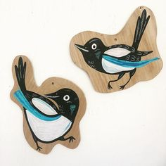 MAGPIES painted on handcut wood. Jenna Alldread