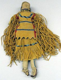 Apache, White Mountain (Native American). Stuffed Doll with Two-piece Dress, Boots and Beaded Barette, late 19th century.