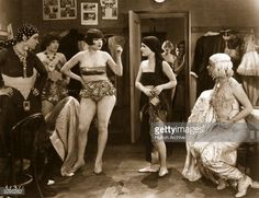 1926: Laura La Plante in the dressing room with several other female performers in various stages of dress in a scene from 'The Midnight Sun', directed by Dimitri Buchowetzki for Universal