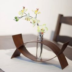 Serendipity  Two individual pieces unexpectedly coming together to form a perfect union. It becomes a complete set to hold the flower vase. The iron