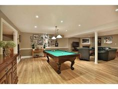 A beautiful set up with a Brunswick Amherst pool table.  Lots of space for the cues