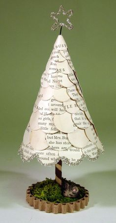 hutch studio: Under The Tree... a sweet little table top decoration that utilized all these little paper coins that were cut out of an old book