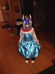 This is my 4 year old son, Gunnar. He loves dressing up as Optimus Elsa. Some days he tells me he's a girl and wants me to do his nails and others he says he's a boy and wants to be like grandpa. He just had the my little pony birthday party with a twilight sparkle cake that he had been asking for, for months. I love his quirky, kind hearted personality. Anything he grows up to be is fine with me. I will always love him no matter what.  -Kelly