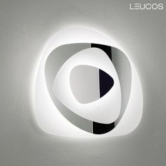 Air design by FlussoDesign for Leucos. Artistic wall or ceiling design with a diffuser finished in a satin white and mirror-like surface. Air is available in two sizes with a fluorescent light source. Both versions are ADA compliant when wall mounted.