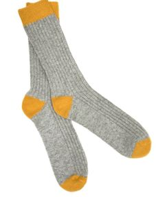 7f0ebbd8cbcb9 Luxury men's socks made from cotton, wool or cashmere blend. Choose from  smart dress socks or thick ribbed socks, in a bold array of colours.
